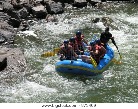 Group Of Friends White Water Rafting.