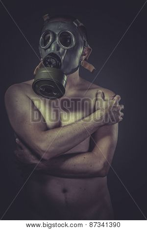 concept of risk of contamination, naked man with gas mask