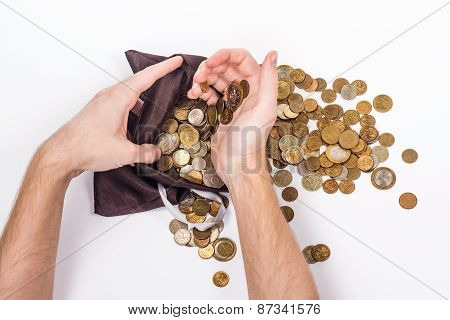 two man's hands holding a gold coins.