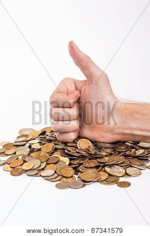 okay sign male hand on pile of gold money.