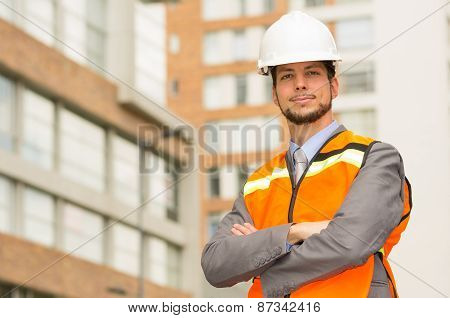 young handsome architect supervising a construction