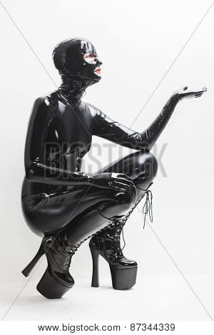 sitting woman wearing latex clothes