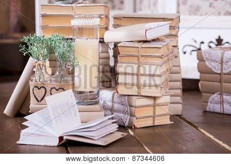 Old Book Heap And Candle In Interior Decoration