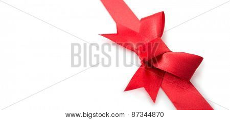 Red ribbon bow or tie,  isolated on white. Shallow depth of field. Wide title header image dimension.