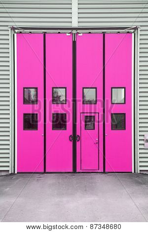 Pink Garage Door on a warehouse building
