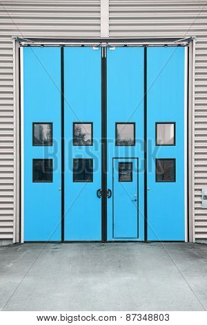Blue Garage Door on a warehouse building