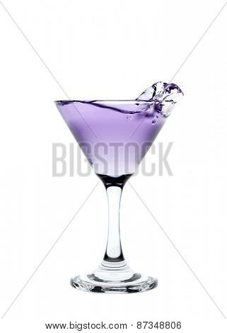 Purple liquid splashing in a martini glass isolated on white background