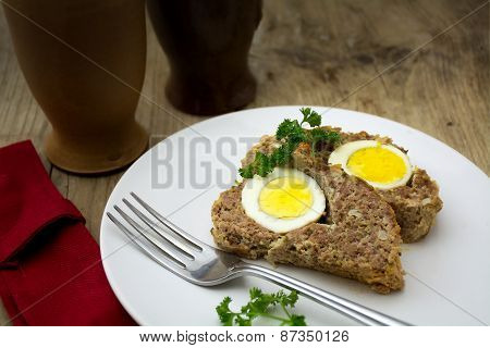 Baked Meatloaf With Boiled Eggs For Easter On Rustic Wood