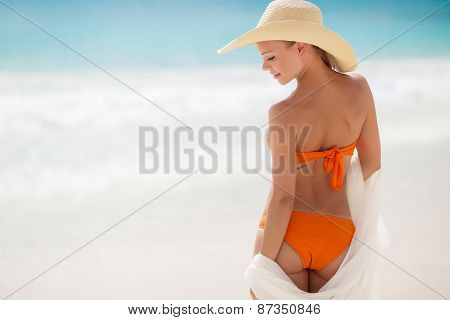 Bronze Tan Woman Sunbathing At Tropical Beach