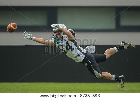 GRAZ, AUSTRIA - APRIL 26, 2014: WR Clemens Erlsbacher (#84 Raiders) fails to catch the ball.