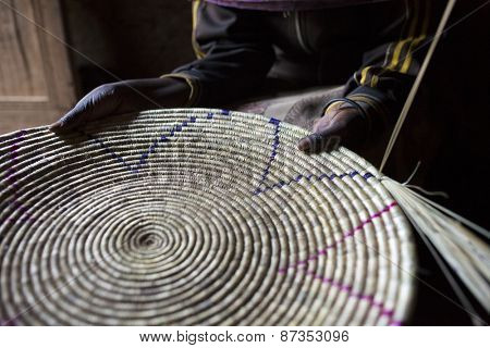 closeup of woman's hands holding handmade basket in Ethiopia