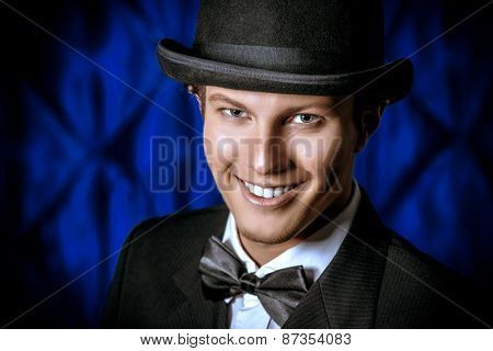 Portrait of a handsome old-fashioned artist man smiling at camera. Fashion, style. Cinema, theater.
