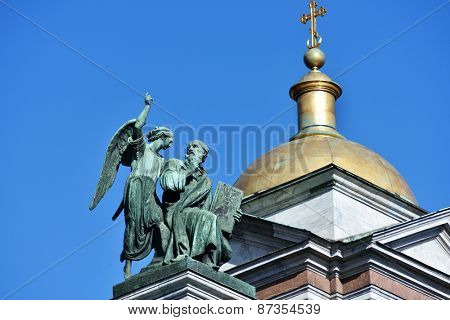 ST. PETERSBURG, RUSSIA - MARCH 5, 2015: Sculpture of apostle Matthew on the St. Isaacs cathedral. Sculptures of apostles for the cathedral created by Giovanni Vitali