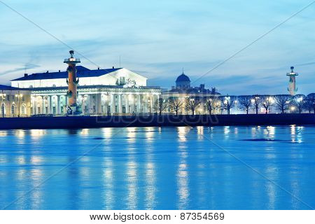 ST. PETERSBURG, RUSSIA - MARCH 18, 2015: Old Saint Petersburg Stock Exchange and Rostral columns on the spit of Vasilievsky island. The architectural complex was completed in 1811
