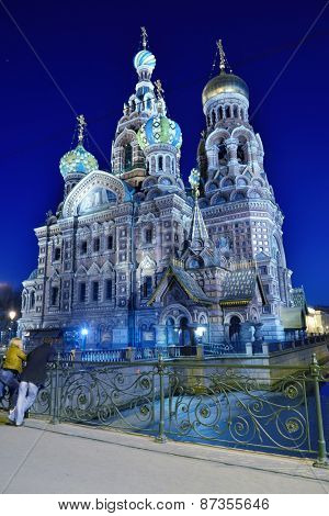 ST. PETERSBURG, RUSSIA - MARCH 16, 2015: People admire the Church of the Savior on Spilled Blood in evening.The Church was built in 1883-1907 on the site where Emperor Alexander II was assassinated