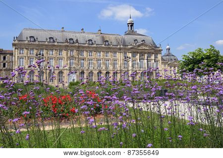 BORDEAUX, FRANCE - JUNE 27, 2013: View to the building of National museum of customs from the embankment of Garonne river. The museum is housed in the building of Hotel des Fermes built in 1735-1738