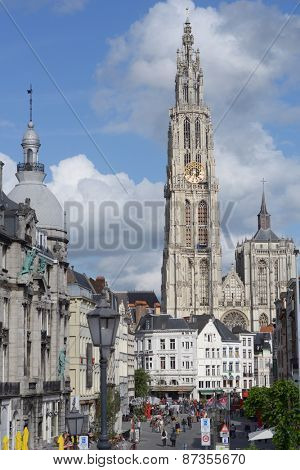 ANTWERP, BELGIUM - JUNE 23, 2013: People against the Cathedral of our Lady. Built between 1352 and 1521 as one of the world tallest buildings, the cathedral still dominates the city skyline