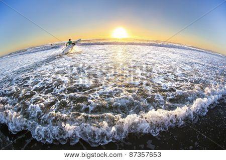 Gold Coast Australia beach sunrise over ocean, surfer
