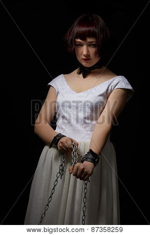 Pretty submissive clutching chain on handcuffs