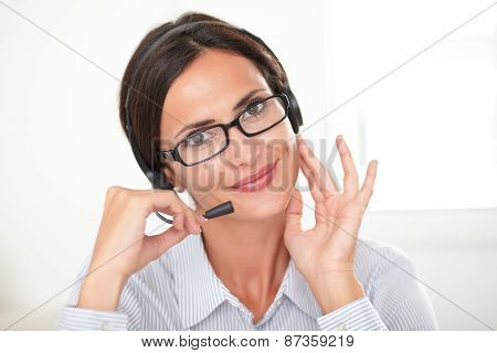 Charming Young Secretary Speaking On Headphones