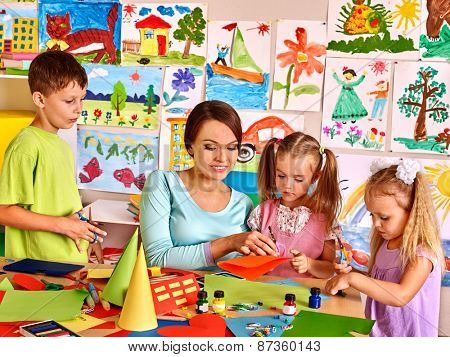 Happy children  with scissors at classroom. Kids education.