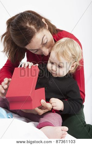 Baby And Mom Opening Red Box