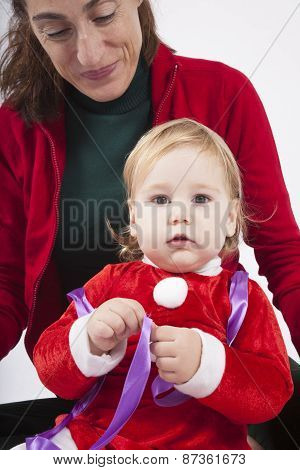 Santa Claus Baby With Mother Looking At Camera