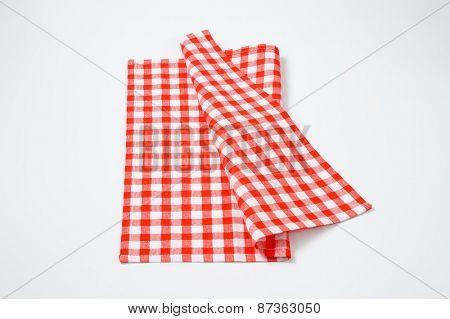 red and white checkered napkin on white background