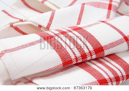 detail of white and red checkered dishtowel
