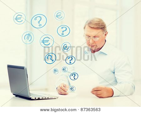 business, tax, office, school and education concept - old man in eyeglasses filling a form at home