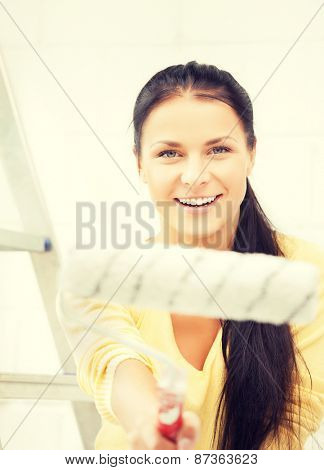 picture of happy young woman with paintroller