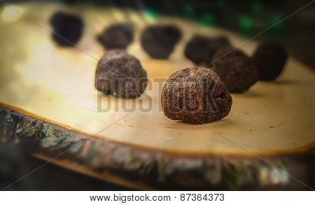 Mushrooms Black Truffle On A Blurred Background