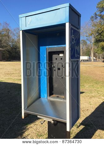 Abandoned public telephone booth