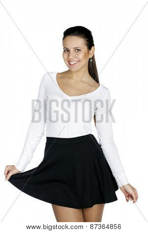 Beautiful smiling busty brunette woman with a beautiful figure in a black skirt and close fitting top isolated on white