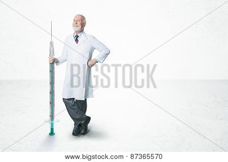 friendly male doctor with huge syringe