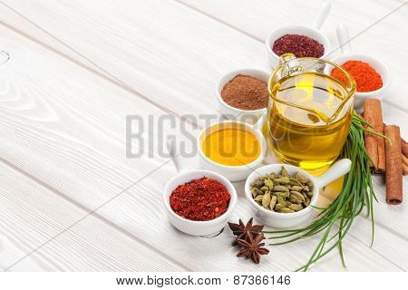 Various spices on white wooden background. With copy space