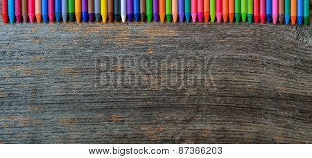 Coloring Pencils Aligned On Wooden Background