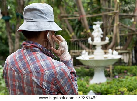 Unidentified Business Man Talking On Mobile Phone With Hand In Jurned
