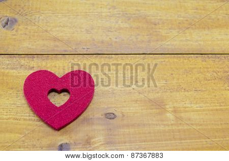 Red Heart On A Wooden Table