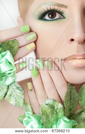 Green makeup and nail Polish.