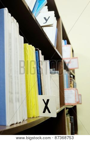 Books in a row. Bookshelf in public library.