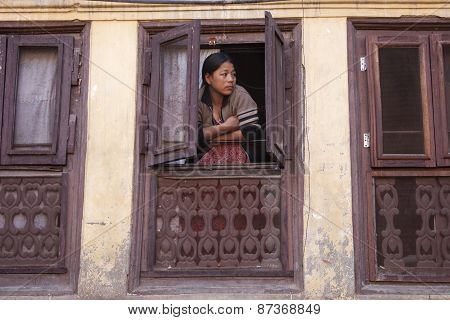 Woman Watch From A Window