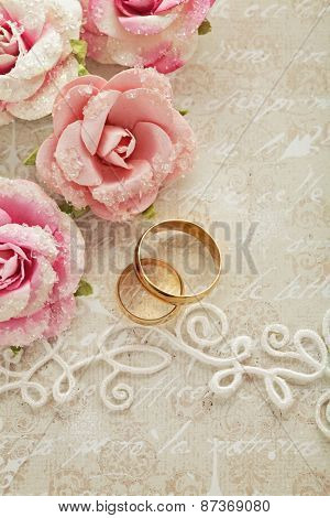 wedding invitation with flowers and wedding rings