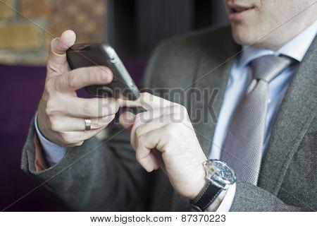 Businessman using smart phone (mobile)