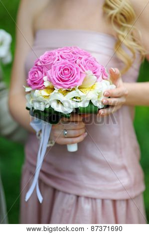 Bridesmaid Holding A Beautiful Wedding Bouquet