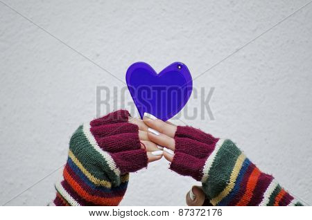 Girl In Mittens Holding A Purple Heart