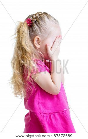 kid girl cover her face with her hand isolated