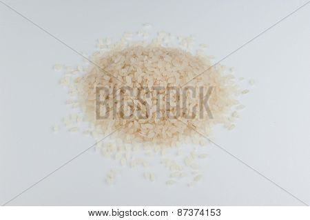 Heap Of Uncooked Risotto Sushi Rice Isolated On A White Background