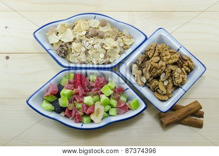 Muesli, Walnuts And Dried Fruit On A Table