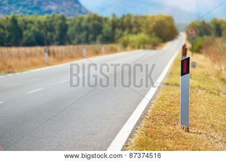 Road Pole On Highway.